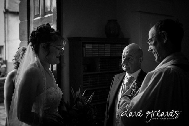 Father of the bride looks with pride at his daughter entering the church