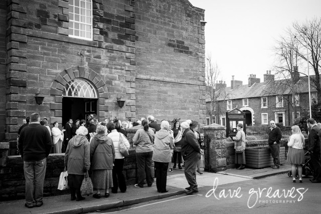 Onlookers wait outside St Mary's Church for the Bride and Groom