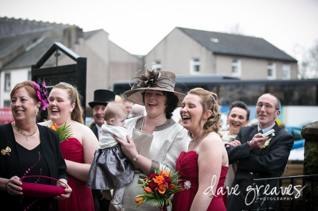 Guests and bridesmaids laughing at wedding