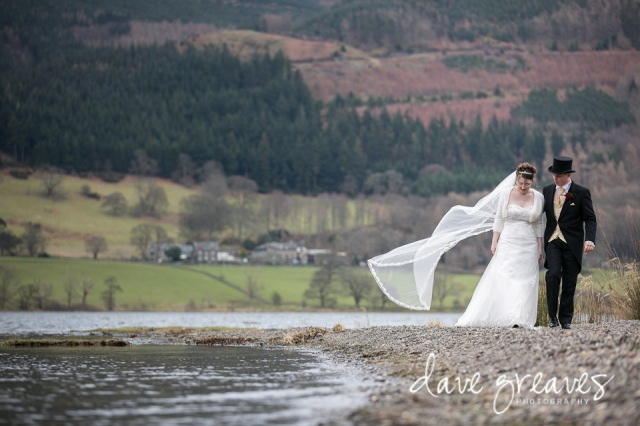 Bride and Groom walk along the shore at Bassenthwaite Lake