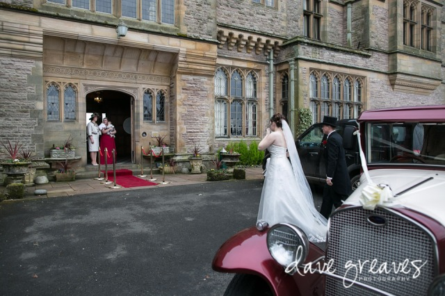 Bride and Groom arrive at Armathwaite Hall in wedding car