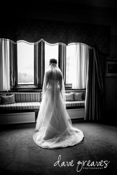 Bridal portrait standing by the window at Armathwaite Hall