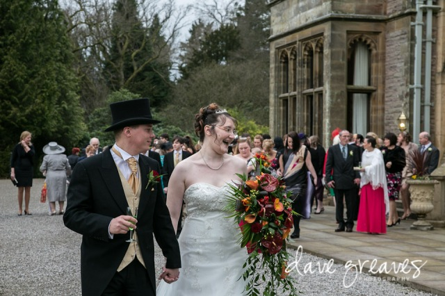 Bride and Groom lead the guests through the grounds of Armathwaite Hall
