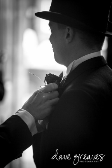 Groom in top hat and tails taken in Black and white