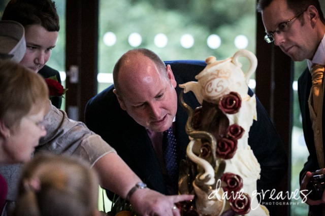 Guest admiring the wedding cake made by Choccywoccydoodah