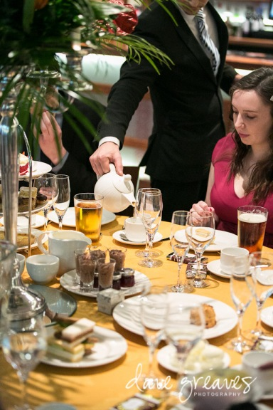 Tea being poured during a wedding reception tea party