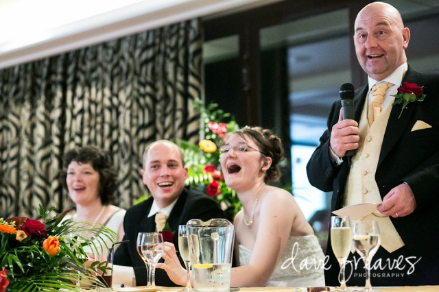 Fater of the Bride Speech with daughter laughing and groom smiling