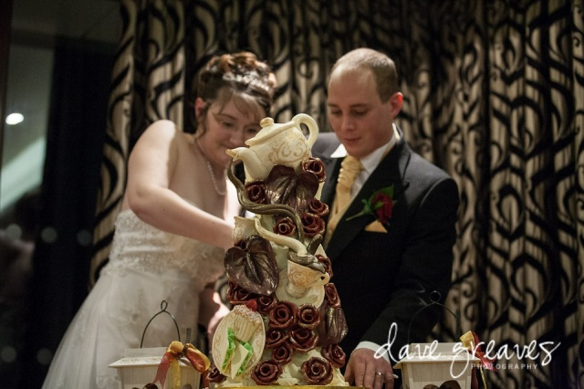 Bride and Groom cutting tea party wedding cake by choccywoccydoodah