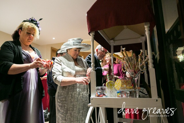 Guests help themselves to sweets from Candy Cart