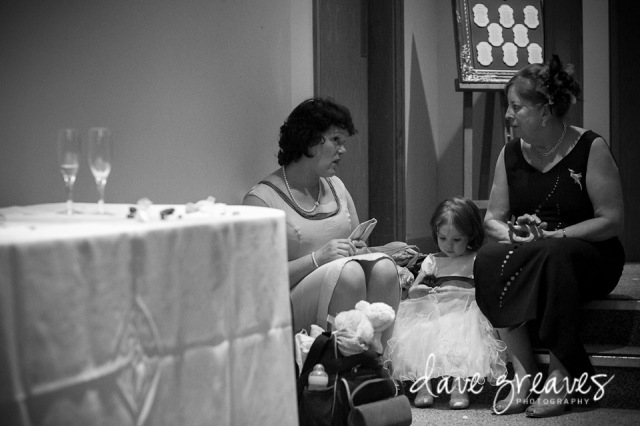 Special moment captured as mothers sit on a step with the flower girl