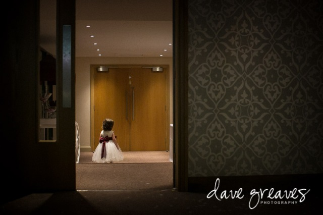 Flower girl standing in a doorway at Armathwaite Hall
