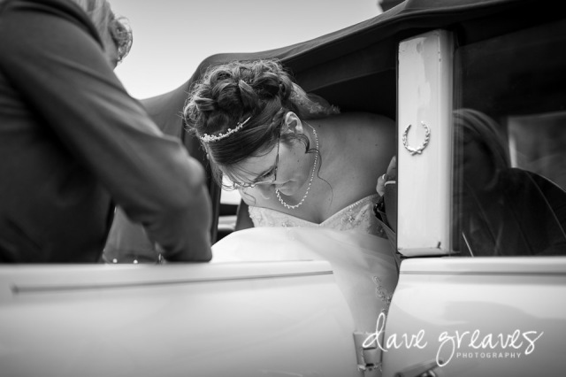 Bride climbs out of the car at St Mary's church Wigton